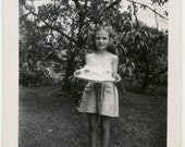 1940s Girl Holding a Cake - snapshot 58-A