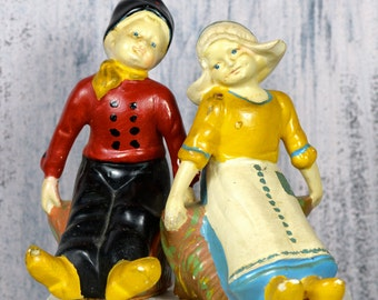 DUTCH boy and girl statues...   girl and boy...   t13 L