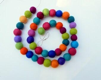 Celebration felt ball garland - felt balls in a mix of bright cheerful colors raspberry teal purple orange green - great gift under 50
