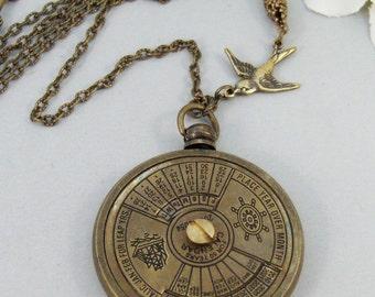 Nautical Calendar,Locket,Necklace,Brass Locket,Steampunk,Antique Locket,Compass,Calendar,Vintage. Handmade jewelry by valleygirldesigns.