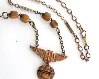 Fourth Estate — vintage wings and journalism badge assemblage necklace