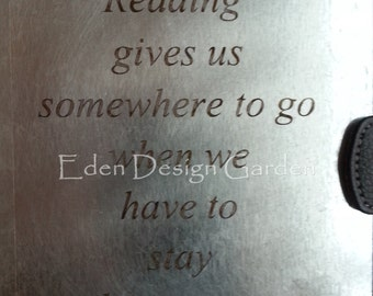 """Etched metal tablet/ereader cover-""""Reading gives us somewhere to go..."""" black vinyl & recycled inner tube"""