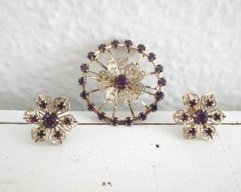 Vintage Purple Rhinestone Brooch Earrings Flower Wheel Gold Tone Filigree Demi Parure Mid Century GallivantsVintage