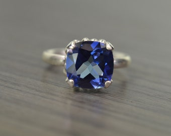 Darcy Ring, Blue Passion topaz 5ct cushion prong solitaire