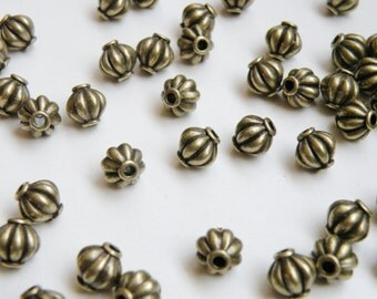20 Lantern or melon shaped spacer beads antique bronze 8mm DB12803