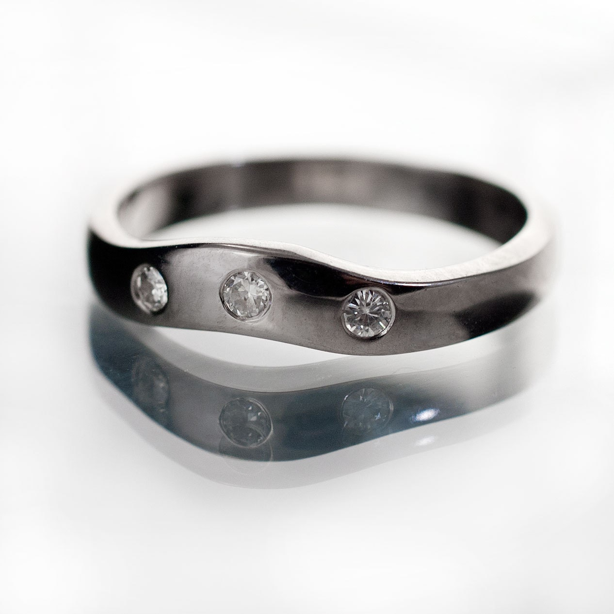 moissanite fitted contoured wedding band in palladium