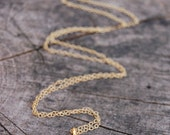 Breathe. Beautiful gold vermeil Om charm necklace.