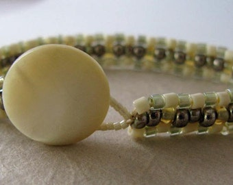 Penzance Bracelet - beadwoven - cream metallic - mother of pearl button