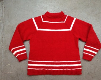 vintage 1980s cozy winter sweater in red with white stripes. retro clothing.