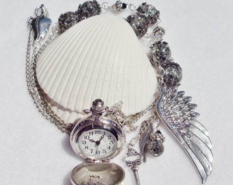 Silver round watch pendant, round silver watch with crystal, glass beads and silver charms and suprise inside