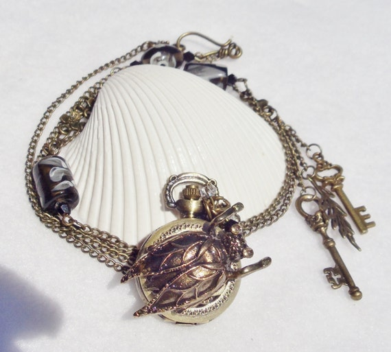 Scarab beetle watch pendant, steampunk pocket watch style, Egyptian scarab beetle adorned with glass beads, crystals and bronze charms