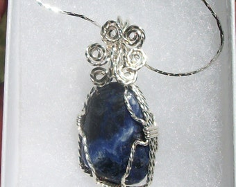 Deep Blue Sodalite cabachon pendant in Silver filled wire