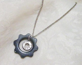 Industrial meets Ammo in this OOAK (One of a Kind) pendant - industrial cog from machine paired with ammo bullet casing