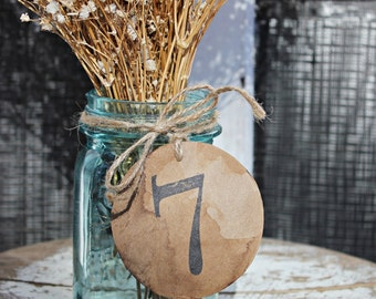 antiqued table numbers . 1 rustic wedding kraft paper table numbers . distressed aged coffee stained table numbers