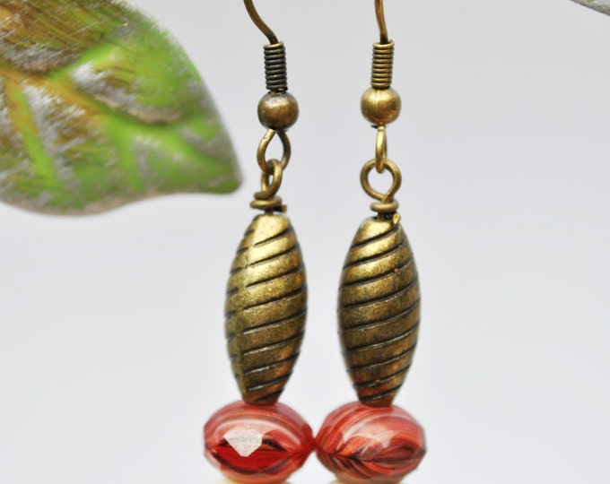 Rust Czech glass beads, carved bone and brass bead earrings