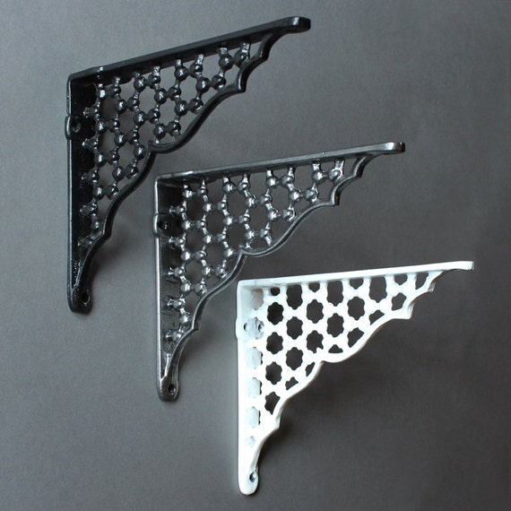 white metal shelf brackets