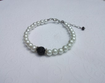 White pearl bracelet with black crystal pave bead