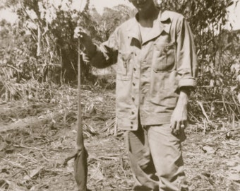 1944 US GI Holding Lizard After Saidon Invasion Snapshot Photo - Free Shipping