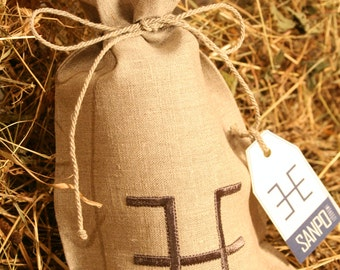 Natural linen gift bag with Latvian Sign ŪSIŅŠ embroidery