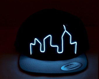 Light Up City Skyline Hat made with El Wire in all colors; blue, green, orange, yellow, pink, purple, white