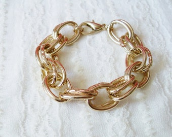 Statement Gold Bracelet. A Chunky Light Gold Chain Bracelet in Double Ring Link. Timeless and Classic.