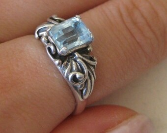 Vintage sterling silver ring with blue gemstone, size 7.5