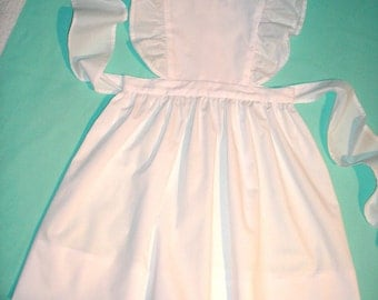 Pinafore Jumper Dress in White broadcloth with eyelet flutter sleeves.  Sizes 4 to 6.  Made to Order.