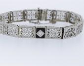 Platinum and 14K Gold Onyx and Diamond Bracelet