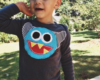 Finn the monster in blue- also available infant and adult sizes