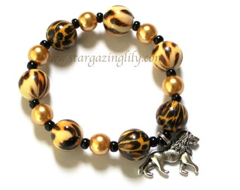 Safari Theme bracelet With Lion charm, animal print beads, and gold glass pearls. Lion Charm or Tiger Charm - Personalize it