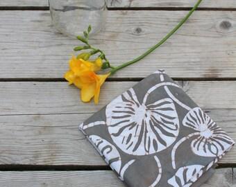 earth gray linen tea towel. waterlily print