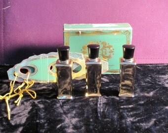 STUDIO GIRL of Hollywood perfume bottles, 3 gold bottles and box.