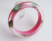 Pink lucite bracelet with real insects