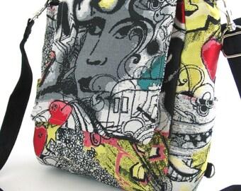 black backpack converts to messenger bag, graffiti art bag, cross body purse,  tote bag, handbag