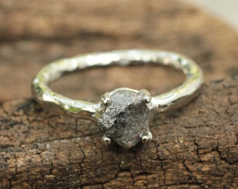 Sterling silver hand textured ring with 0.80 carat rough diamond