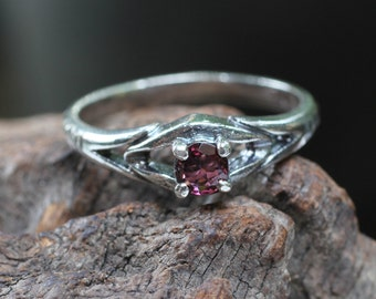 Sterling silver ring with red spinal gemstone
