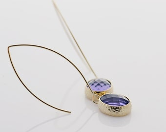 Purple Oval Glass Earrings With A Shiny Gold Tone Frame