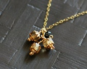 cathedral - gold bead necklace