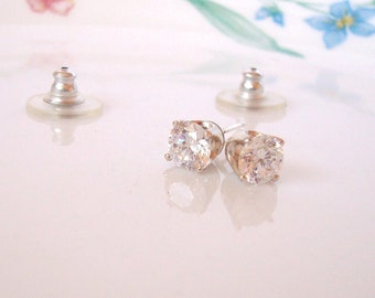 sterling silver prong set CZ stud and post earrings - 6mm round with a shiny polished finish