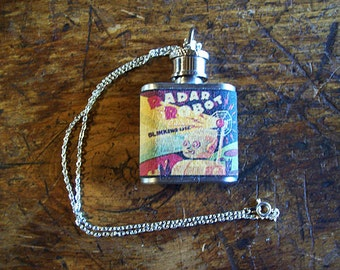 robot flask necklace retro vintage 1950's tin toy jewelry science fiction clip on flask kitsch