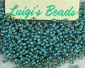 11/0 Round Toho Japanese Glass Seed Beads #953-Jonquil/Turquoise Lined 15g - Use coupon code LUIGIS10 for 10% off