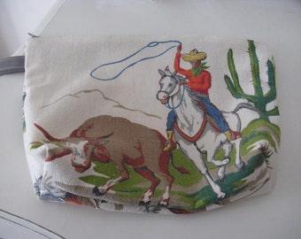 Vintage barkcloth wristlet - Cowboys