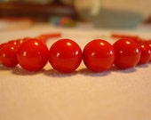 Red plastic bead necklace 1980's style