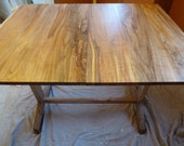 Extendable Trestle Dining Table with Modern Detail