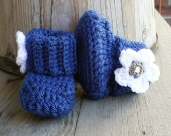 Crochet baby girl boots, in blue with white flower and jewel button center. size 0 to 3 mo. Great for  BYU fans,  or the Dallas Cowboys.