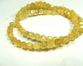 Golden Rutilated Quartz Gemstone, Faceted Rounds, 5.5mm. Packet of 20.  (2qr) Reduced from 7.80