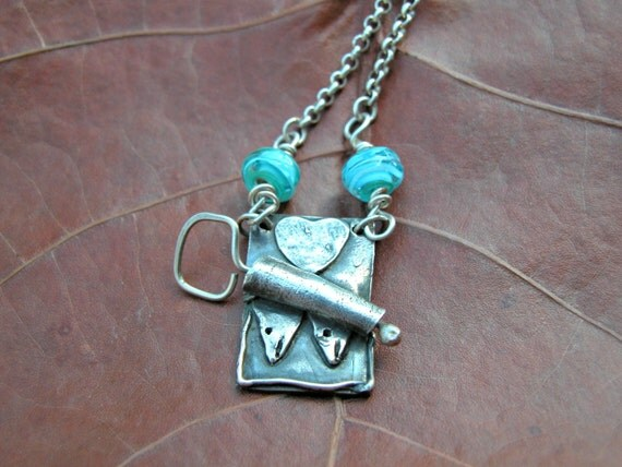 silver can of sardines necklace with aqua lamp work beads