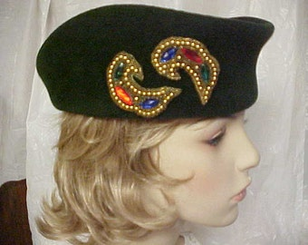 Green velour oblong hat with pretty beaded side decoration- fits 22 inches