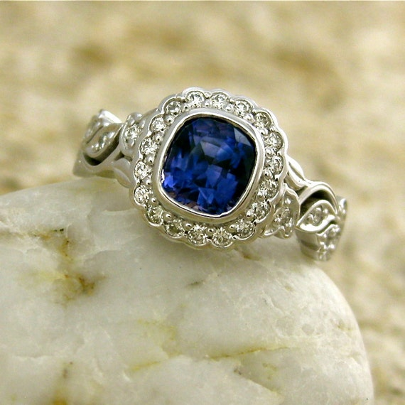 dark blue sapphire engagement ring in 14k white gold with