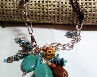 Charm and Bead Necklace - turquoise - rust - silver chain - skull - charms - leather